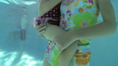 Two girls in a swimming pool Stock Footage