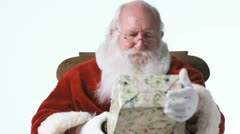 Santa Claus giving a gift Stock Footage