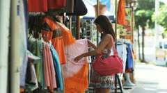 woman shopping on a Costa Rican street - stock footage