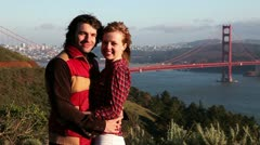 Young couple at the Golden Gate Bridge Stock Footage