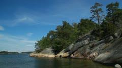 Rocks at sea edge on shorline in Stockholm archipelago Stock Footage