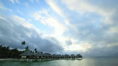 time lapse movie of a tahitian resort as dark clouds creep in over the beach - stock footage
