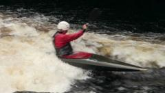 Man in kayak paddling in white water rapids Stock Footage