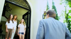 Caucasian Father Being Greeted by Family Stock Footage