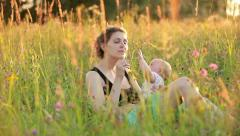 Mother ahd baby in the meadow Stock Footage