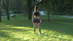 Stretching before jogging Stock Footage