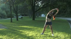 Woman stretching before jogging Stock Footage