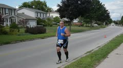Overweight fat man running marathon runner Stock Footage
