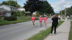Pink amateur female runners girls women running Stock Footage