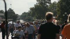 Stock Footage - Iowa State Fair - HD1080p - Hundreds of poeple on main street Stock Footage