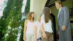 Mother Daughters Arriving View Property Stock Footage
