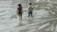 Children playing in a river Stock Footage