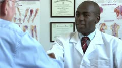 African American doctor shaking hands with patient - stock footage