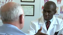 Doctor meeting with patient, using tablet - stock footage