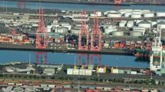 Freight Vessel Being Unloaded at Busy Harbor - Aerial View - stock footage