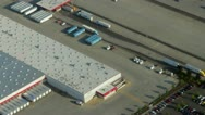 Stock Video Footage of Large Freight Distribution Center and Semi-Trucks