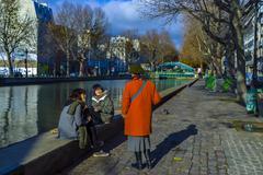 paris, france, street scene, people on the canal saint martin, autumn - stock photo
