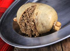 Scottish Haggis Cooked On A Silver Plater Ready For Serving Stock Photos