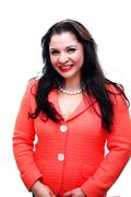 Happy Latin Hispanic Woman Wearing A Pink Jacket, White Background - stock photo