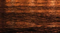 Golden water reflections Thames UK Stock Footage
