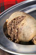 Hot Scottish Haggis On A Silver Platter Ready For Serving - stock photo