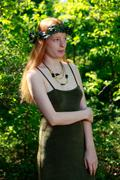 Beautiful Redhead Young Woman Outdoors In The Woods Wearing An Ivy Crown  - stock photo