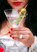 Anonomous Woman With Red Lipstick Holding A Martini Glass With Olives Stock Photos