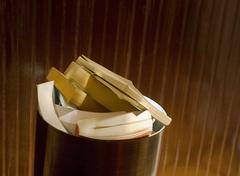 books in office trash container - stock photo