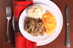 Looking Down On A Scottish Haggis Dinner Plate Place Setting Stock Photos