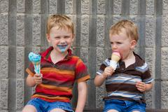 Boys eating ice cream Stock Photos
