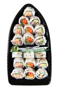 Overhead View Looking Down On A Fresh Food Japanese Rice Sushi Boat - stock photo