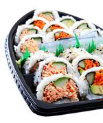 Japanese Sushi Boat Variety Of Fresh American Style Sushi - stock photo