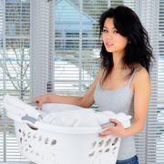 Asian Woman Carrying Laundry - stock photo