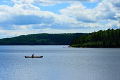 Canoeist on wilderness lake Stock Photos