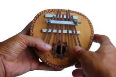 Hands play kalimba Stock Photos