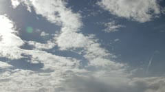 Fluffy clouds over Blue Sky Stock Footage