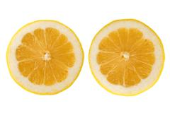 two fresh lemon halves - stock photo