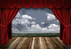 Dramatic stage with red velvet theater curtains Stock Photos