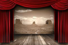 Red theater curtain drapes with desert mountain background Stock Photos