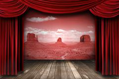 red theater drapes with desert landscape backdrop - stock photo