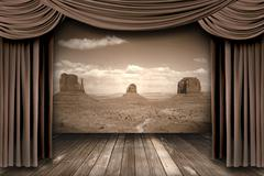 hanging stage theater curtains with a desert  background - stock photo