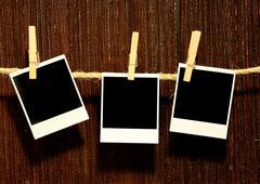 hanging vintage grunge blank polaroids - stock photo
