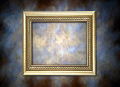 Stock Photo of golden frame against painted background