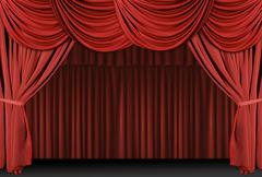 Old fashioned, elegant theater stage with velvet curtains. Stock Photos