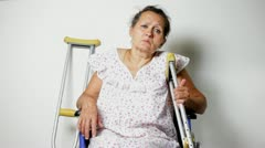 Mature woman in a wheelchair Stock Footage
