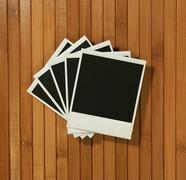 vintage polaroid frames on bamboo background - stock photo