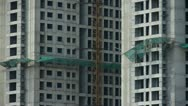 Construction site building & hanging tower crane. Stock Footage