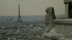 Gargoyle on the Sacre-Coeur with the Eiffel Tower in the distance - stock footage