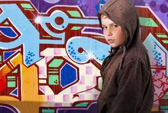 child over graffiti background - stock photo