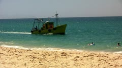 Troia beach with fisher boat - Setubal, Portugal Stock Footage